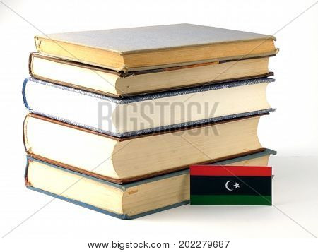 Libyan Flag With Pile Of Books Isolated On White Background