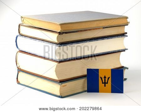 Barbados Flag With Pile Of Books Isolated On White Background