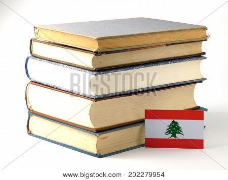 Lebanese Flag With Pile Of Books Isolated On White Background