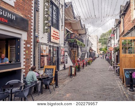 GLASGOW, SCOTLAND - JULY 20: Beautiful Ashton Lane on July 20, 2017 in Glasgow, Scotland. Ashton Lane is a trendy area with pubs close to the University of Glasgow in the west end.