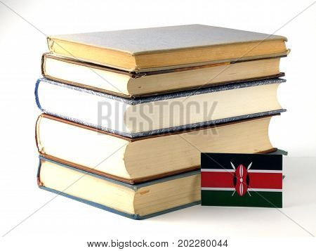Kenyan Flag With Pile Of Books Isolated On White Background