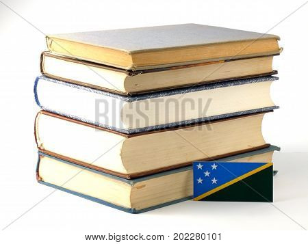 Solomon Islands Flag With Pile Of Books Isolated On White Background