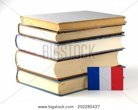 French Flag With Pile Of Books Isolated On White Background