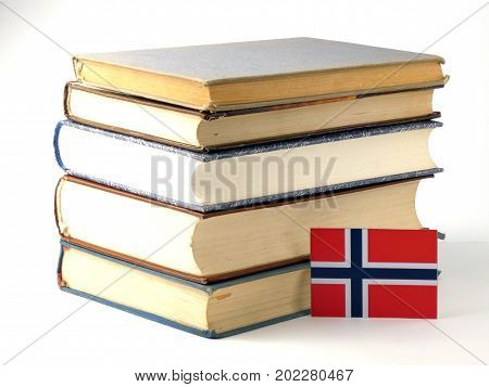 Norwegian Flag With Pile Of Books Isolated On White Background