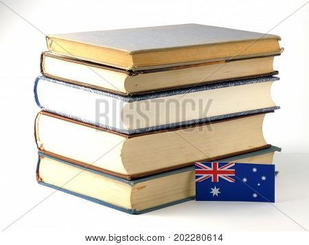 Australian Flag With Pile Of Books Isolated On White Background