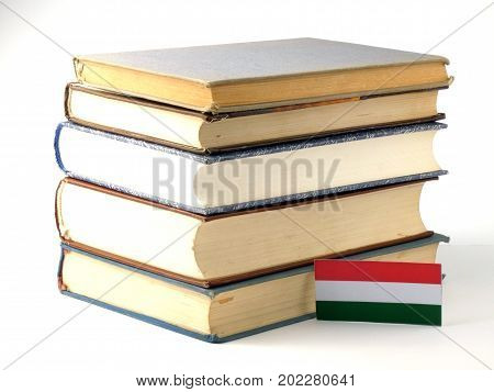 Hungarian Flag With Pile Of Books Isolated On White Background