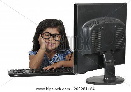 Beautiful computer savvy little girl using a computer