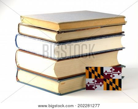 Maryland Flag With Pile Of Books Isolated On White Background