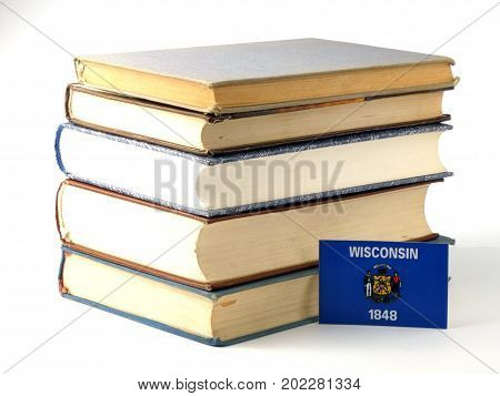 Wisconsin Flag With Pile Of Books Isolated On White Background