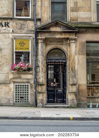 GLASGOW, SCOTLAND - JULY 21: The Piper Bar on July 21, 2017 in Glasgow, Scotland. The Piper Bar is a popular pub and whisky bar across the street from George Square.