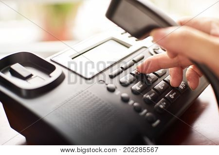Telephone dialing contact and customer service concept. Selected focus.
