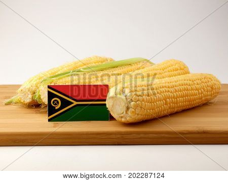 Vanuatu Flag On A Wooden Panel With Corn Isolated On A White Background
