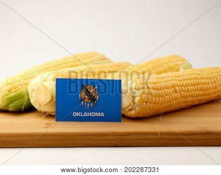 Oklahoma Flag On A Wooden Panel With Corn Isolated On A White Background