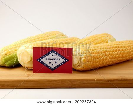 Arkansas Flag On A Wooden Panel With Corn Isolated On A White Background