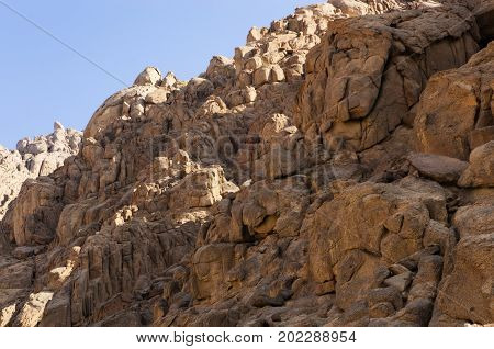 Brown rocks of Sinai, against the sky