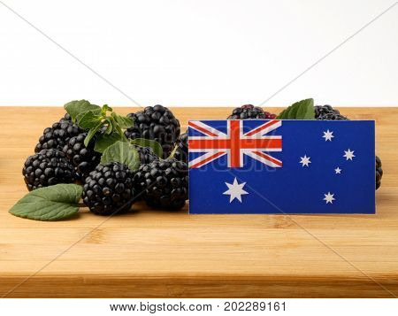 Australian Flag On A Wooden Panel With Blackberries Isolated On A White Background