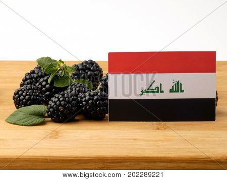 Iraqi Flag On A Wooden Panel With Blackberries Isolated On A White Background