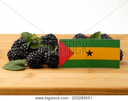 Sao Tome And Principe Flag On A Wooden Panel With Blackberries Isolated On A White Background