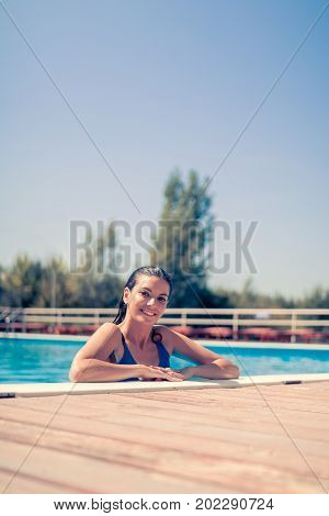 One Young Adult Woman Smiling, Head And Shoulder Shot, Caucasian Model, In Swimming Pool, Looking To