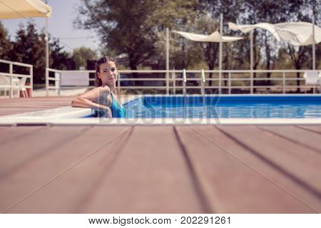 One Young Adult Woman, Posing, Relaxing Swimming Pool Edge, Water, Looking To Camera, Wet Long Hair,