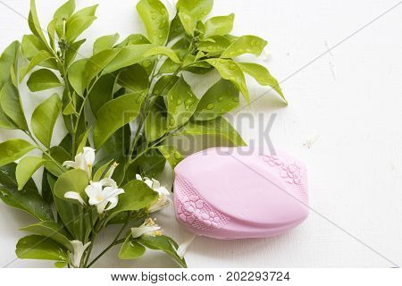 chunk of pink soap fragrance of the flower from nature for health and sanitation skin on white