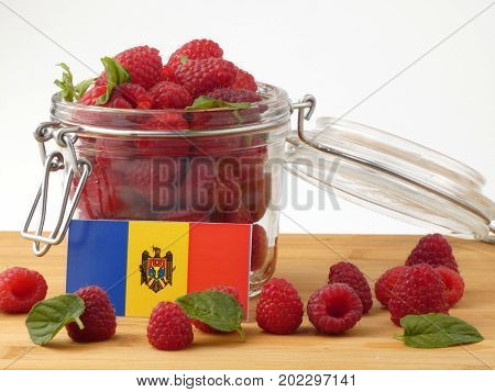 Moldovan Flag On A Wooden Panel With Raspberries Isolated On A White Background