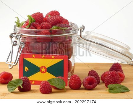 Grenada Flag On A Wooden Panel With Raspberries Isolated On A White Background
