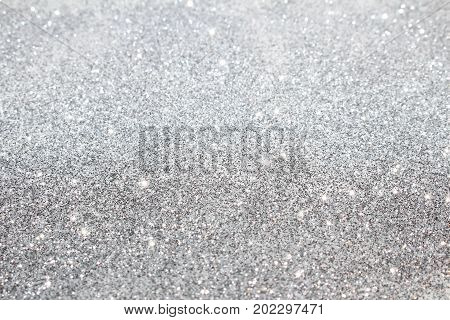 beautiful shiny background with patches and sequins on a light background