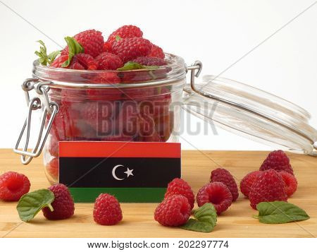 Libyan Flag On A Wooden Panel With Raspberries Isolated On A White Background