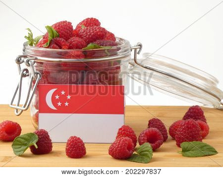 Singaporean Flag On A Wooden Panel With Raspberries Isolated On A White Background