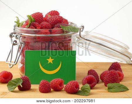 Mauritania Flag On A Wooden Panel With Raspberries Isolated On A White Background
