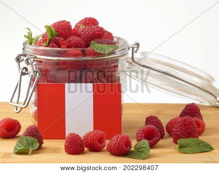 Peruvian Flag On A Wooden Panel With Raspberries Isolated On A White Background