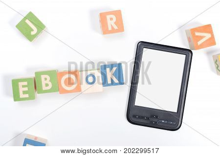 e-book reader device and toy blocks top view concept