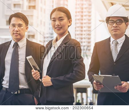 Woman leadership - Smart business woman standing with confidence in front of business men. Leadership of woman concept.