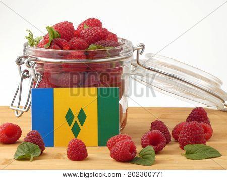 Saint Vincent And The Grenadines Flag On A Wooden Panel With Raspberries Isolated On A White Backgro