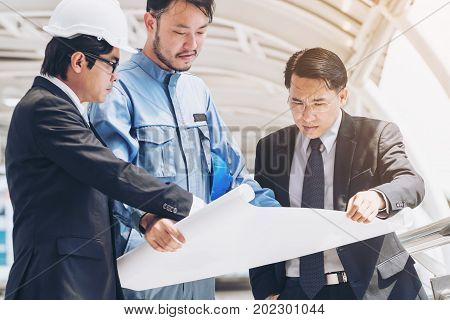 Engineer And Business Man Discuss About Blueprint