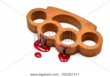 Brass knuckles with blood on a white background