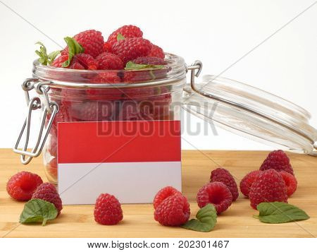 Indonesian Flag On A Wooden Panel With Raspberries Isolated On A White Background