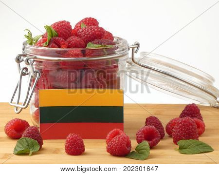 Lithuanian Flag On A Wooden Panel With Raspberries Isolated On A White Background