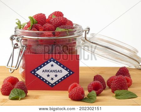 Arkansas Flag On A Wooden Panel With Raspberries Isolated On A White Background