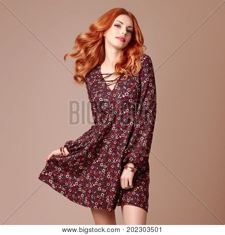 Fall Fashion. Model Woman in Autumn fashion Outfit. Boho Girl in Floral Dress. Stylish Wavy Hairstyle. Glamour Playful Redhead Sexy Girl. Fashion Pose. Fall autumn Concept. Creative Vintage