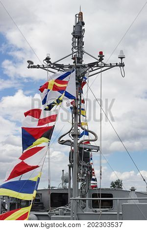 The radar of a warboat decorated flags