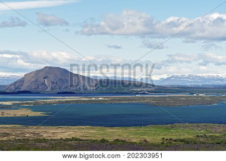 Typical Iceland sea lanscape on the east coast with farms in fjords.