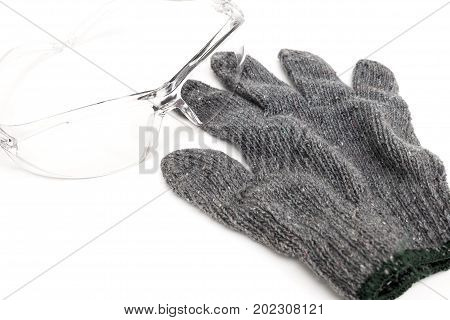 Knitted glove with safety goggle isolated on white background