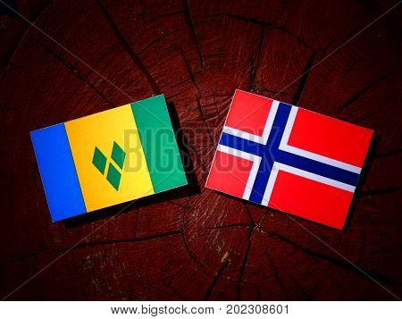 Saint Vincent And The Grenadines Flag With Norwegian Flag On A Tree Stump Isolated