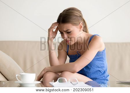 Stressed confused young woman feeling frustrated after reading paper letter, written bank notification. Credit debt, overdue loan, financial problem, bankruptcy, lost savings, job contract termination