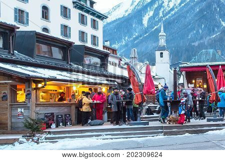 Chamonix, France - January 25, 2015: Outdoor Bar during Happy hour and people relaxing after ski in Chamonix town in French Alps, France