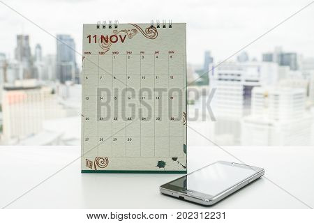 November calendar with smartphone for meeting and appointment reminder