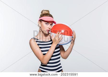 Beautiful Woman In Swimwear With Beach Ball