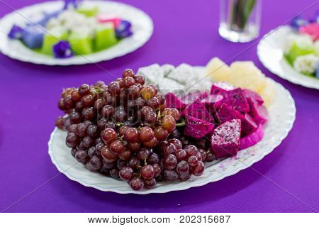 delicious fruit grapes dragon fruit melon on the white bowl healthy food for everybody with copy space